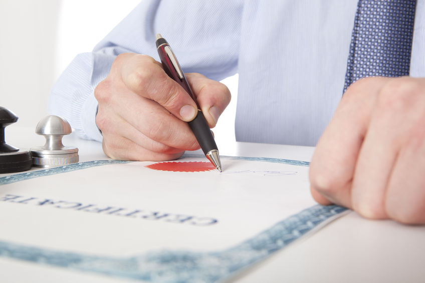 Lawyer / Professional signing a certificate
